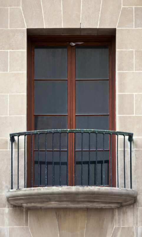 A Balcony with a Metal Railing