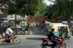 A Bicycle, a Cab and a Motorycle Drive By