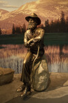 A Bronze Sculpture of John Muir Seated on a Rock
