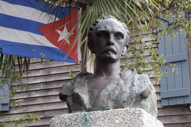 A Bust of Jose Marti with a Cuban Flag in the Background
