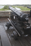A Cannon on a Wet, Wood Deck