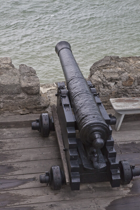 A Cannon Pointing over the Water