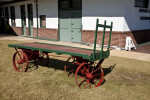 A Cargo Wagon with Red, Metal Wheels