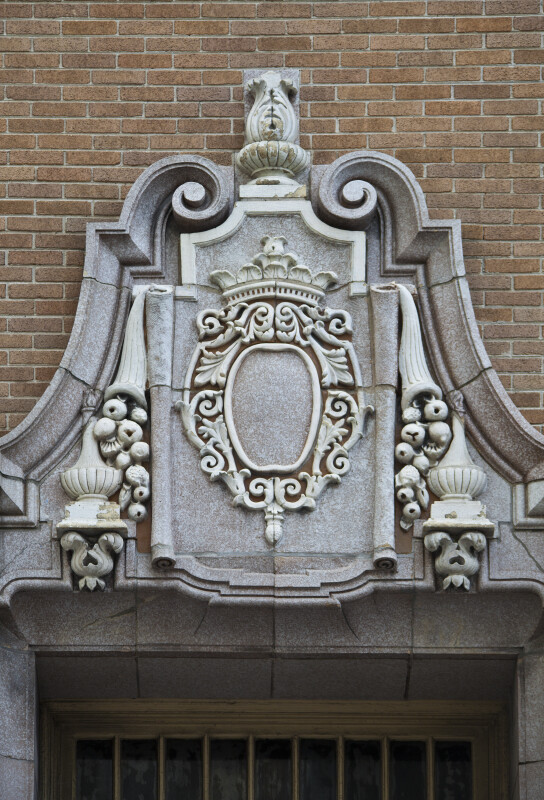 A Cartouche over a Balcony Door