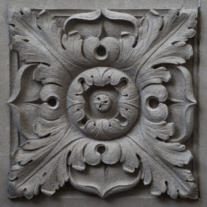 A Carved Panel with a Circular Flower