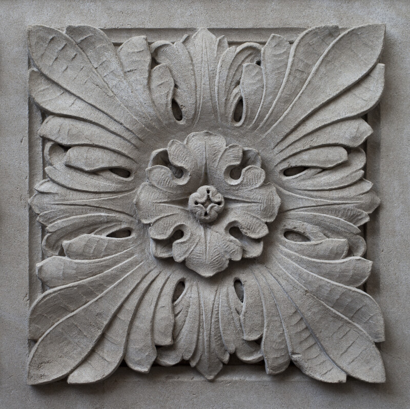 A Carved Panel with a Flower in the Center
