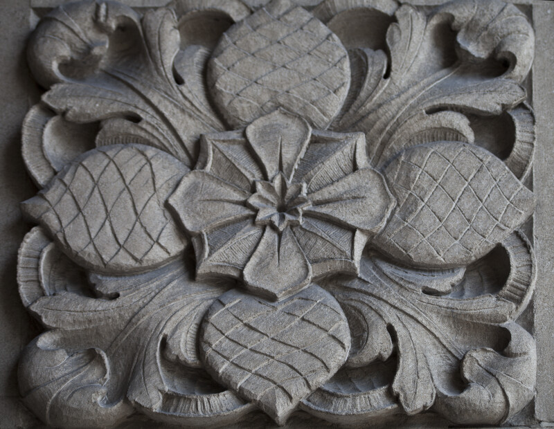 A Carved Panel with a Pine Cone Motif