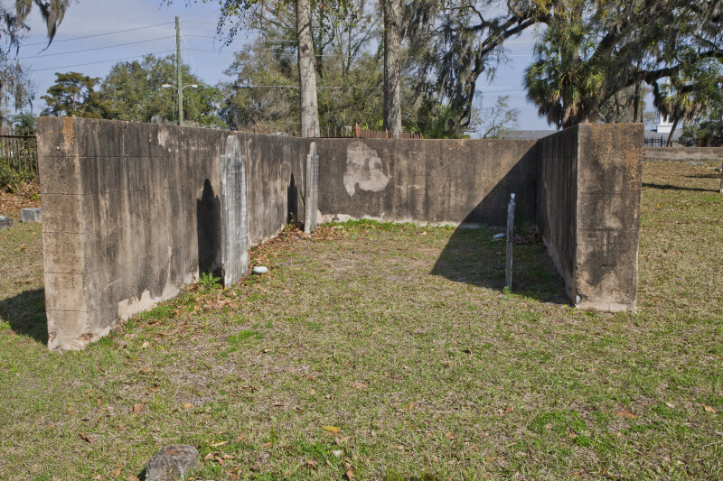A Cinder Block Enclosure around Three Graves