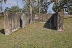 A Cinder Block Enclosure around Three Graves