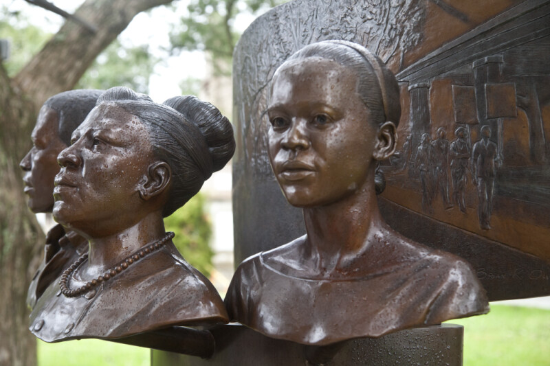 A Civil Rights Monument with Four Busts and a Shallow Relief Carving