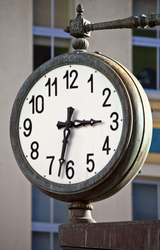 A Clock Mounted on the Exterior of a Building