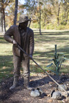 A Close-Up of a Bronze Sculpture of a Farmer in a Public Park