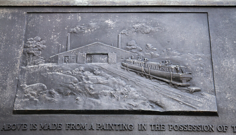 A Close-Up of a Metal Plaque Showing Engine House Number Six