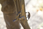 A Close-Up of a Rifle Hammer That is Part of a Bronze Sculpture