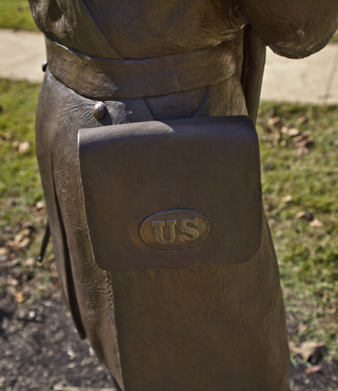 A Close-Up of an Ammunition Pouch on a Bronze Sculpture of a Soldier