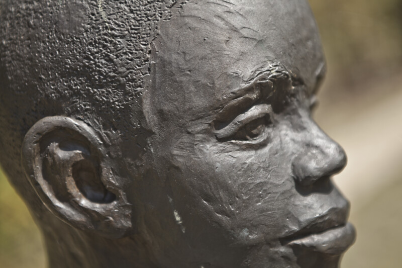 A Close-Up of the Face of a Bronze Figure Depicting a Young Boy at Corinth Contraband Camp
