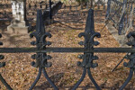 A Closer View of a Metal fence around a Cemetery Plot