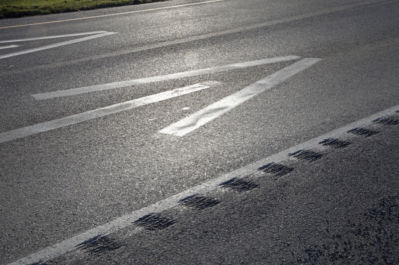 A Closer View of Arrows Painted on a Road Surface