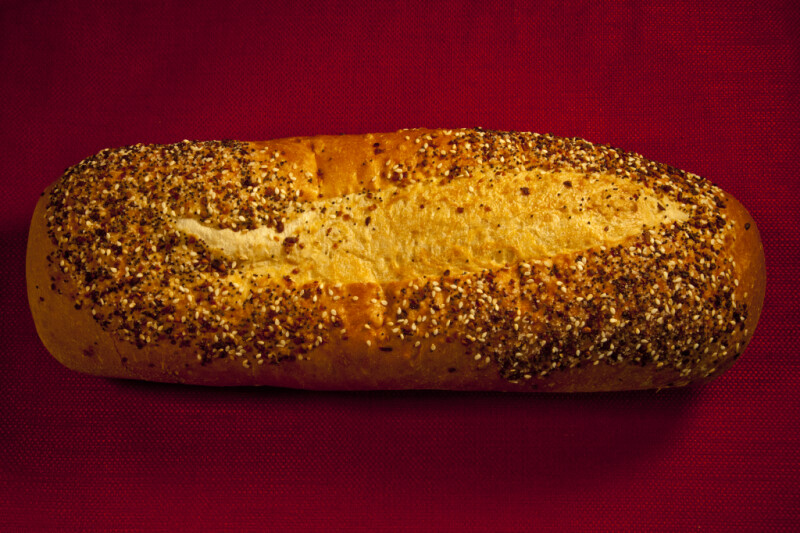 A Closeup of a Loaf of a Seeded Italian Bread