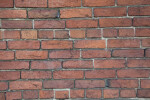 A Common Bond Brick Wall with a Cracked Brick