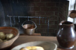 A Copper Pot in the Fireplace