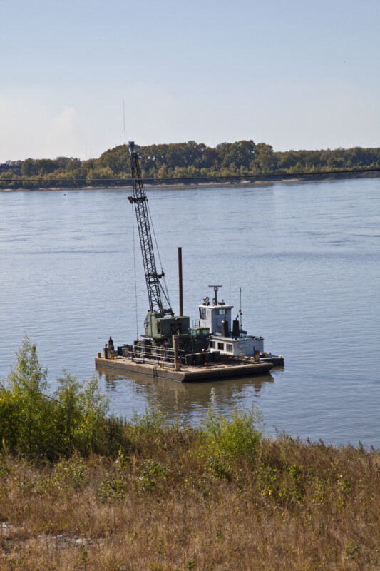 A Crane Anchored in Wolf River Harbor