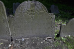 A Damaged Carving on a Headstone
