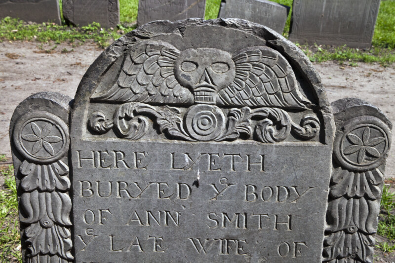 A Death's Head and Flowers on a Tablet Headstone