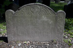 A Death's Head on a Shouldered Tablet Headstone