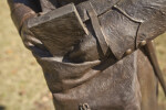 A Detailed View of the Sleeve of a Bronze Sculpture