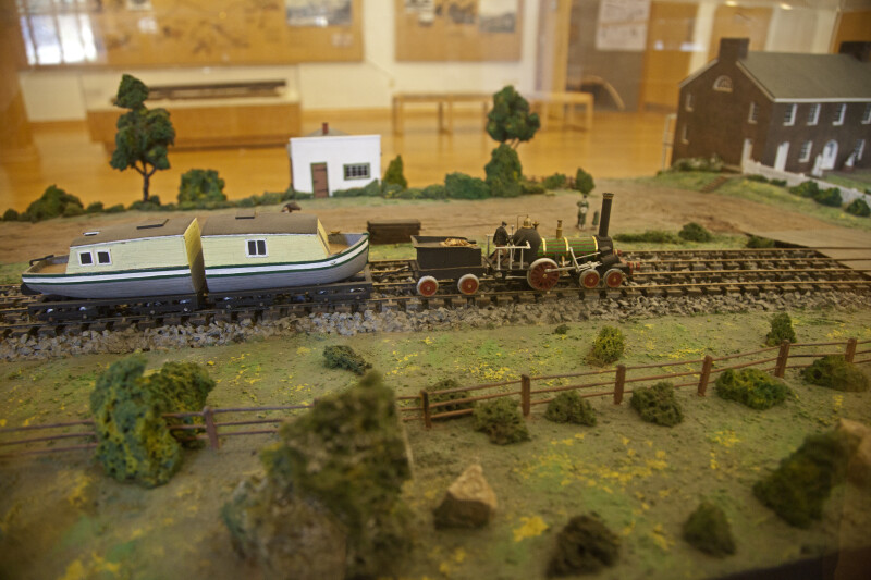 A Diorama of a Disassembled Barge Pulled by a Locomotive