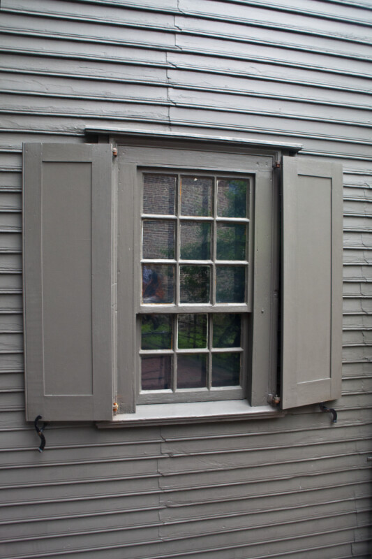 A Divided Window, with Shutters