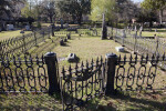 A Fence around Cemetery Headstones