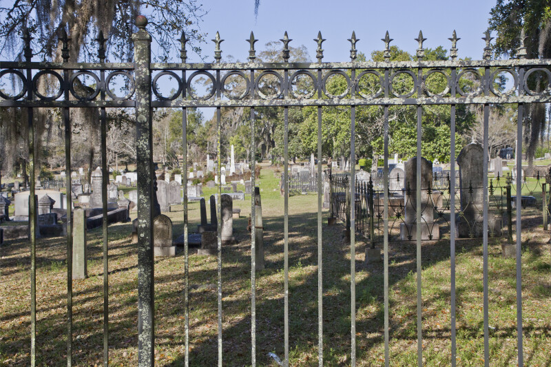 A Fence Demarcates the Boundary of a Cemetery