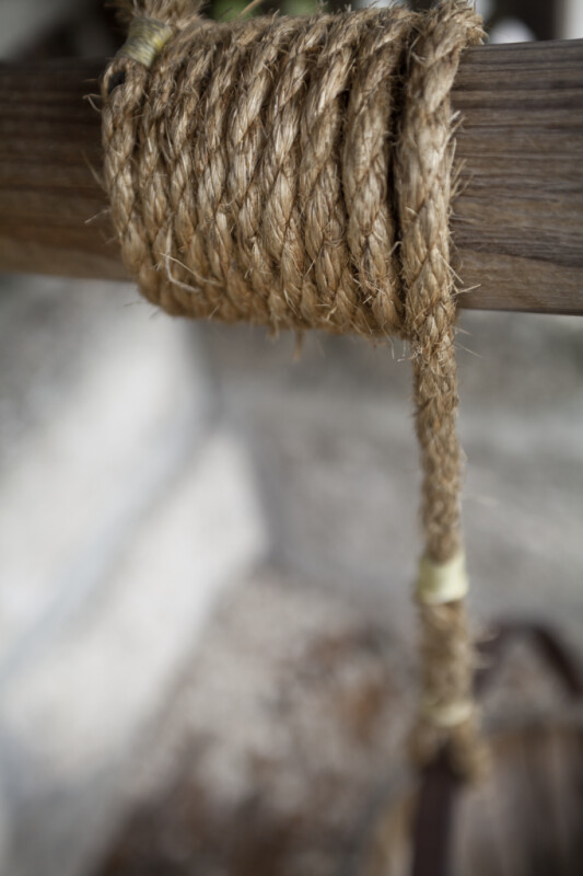 A Fiber Rope Wrapped around a Wooden Well Crank