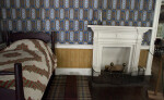 A Fireplace Screen by the Bed