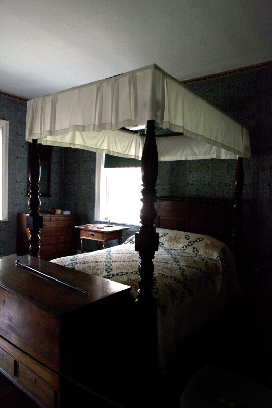 A Four-Poster Bed in a Dimly Lit Room