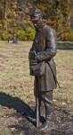 A Full_Length View of a Bronze Sculpture of a Soldier