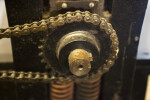 A gear in the side of a printing press.