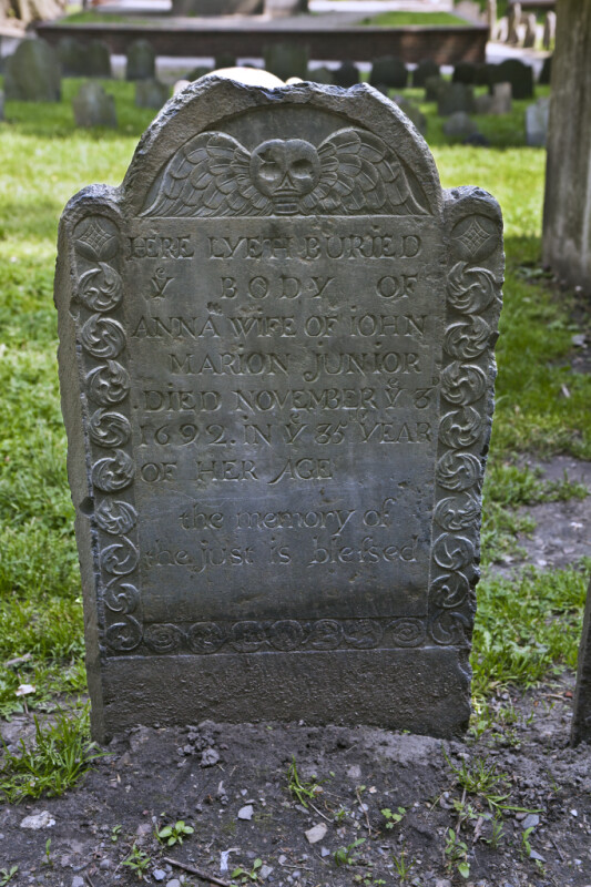 A Headstone with a Chipped Top