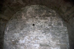 A Hole in a Wall at the End of a Barrel Vault
