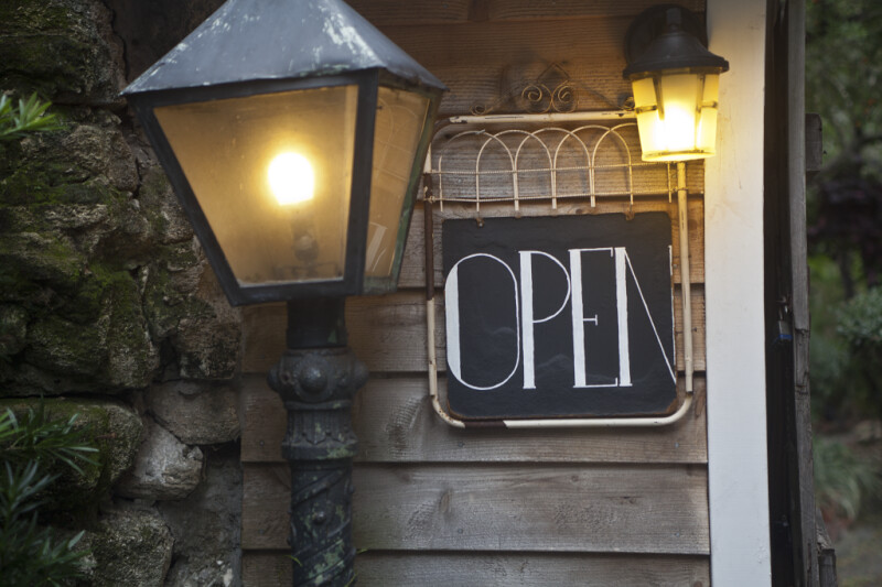 """A Lamp near an """"OPEN"""" Sign"""