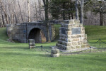 A Large, Sandstone Monument, with Metal Plaques, near Skew Arch Bridge