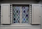 A Leaded Casement Window, with Shutters