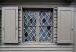 A Leaded Casement Window, with Shutters