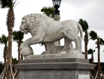 A Marble Sculpture of a Lion with a Ball