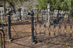 A Metal Fence around a Cemetery Plot