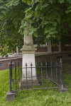 A Metal Fence Surrounding an Obelisk