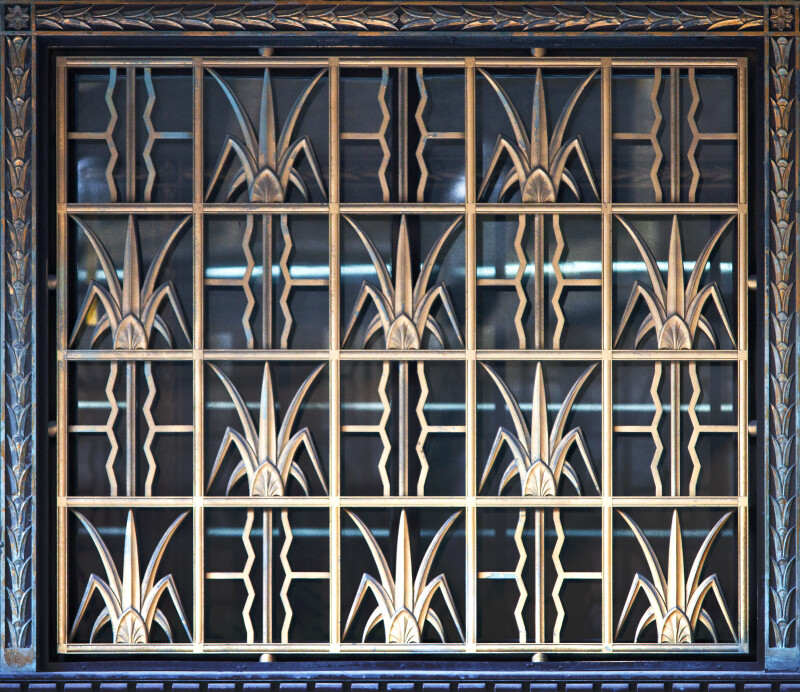 A Metal Grille, with Plant Motif, Covering a Window