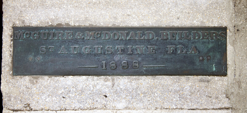 A Metal Plaque on Poured Concrete